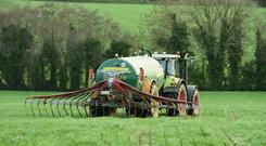 Kevin O Hanlon spreading slurry on his farm at Ballywilliam, Co Wexford Photo: Roger Jones