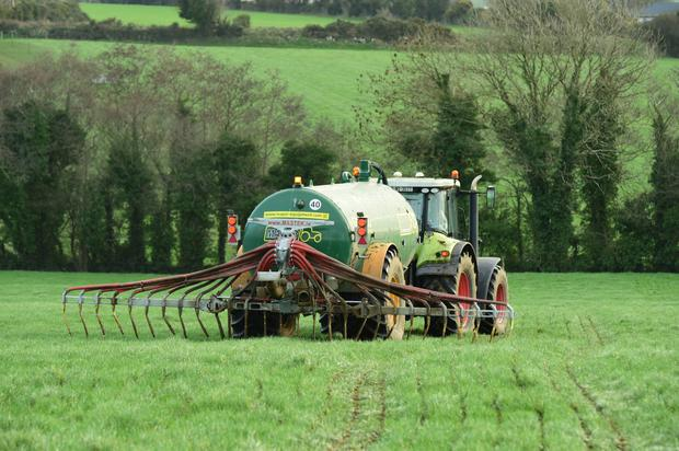 Kevin O Hanlon spreading slurry on his farm at Ballywilliam, Co Wexford yesterday. He says grass growth has been very strong and the cows have been out grazing sincee January 8. Photo: Roger Jones