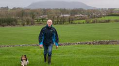 Philip Higgins with his dog, Pippa,on his farm in Skreen, Co Sligo. Photo by Brian Farrell