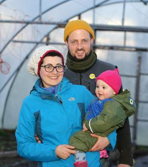 Fergal Anderson, his wife Emanuela Russo and their baby Nessa at their farm in Kilrickle, Loughrea, Co. Galway.