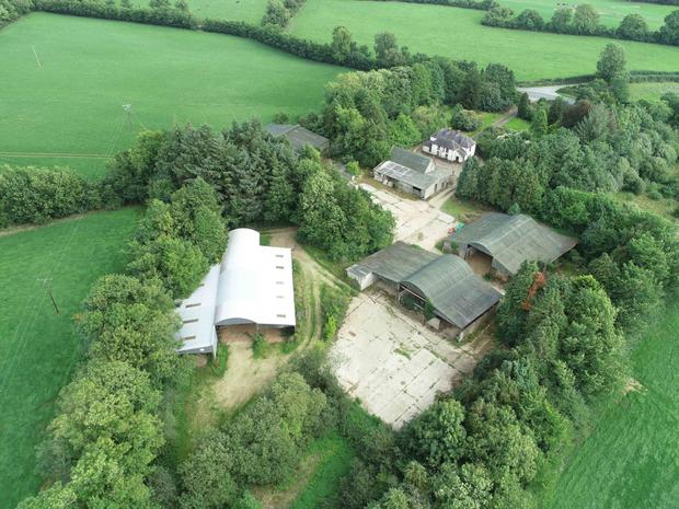 The holding comes with a traditional-style farmhouse and an extensive range of sheds and outbuildings