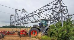The tractor in the photo had been set to auto steer when it crashed into the pylon.