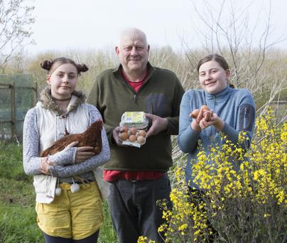 Organic farmer Mark Wilson-Pierce with his daughters Phoebe(11) and Síofra(13) at their home farm Rathlir Farm, near Kilrush, Co. Clare with one of their free range chickens and eggs.