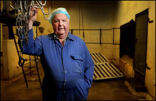 Hooked: Dominic Feely at his abattoir 'Feely Meats' near Daingean in Co Offaly. Photo: Steve Humphreys