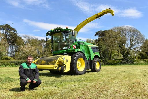 Top of the crops: Michael Lagan with his new John Deere 9900i harvester, the first to be sold in Europe.