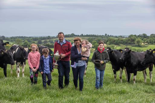 Milky way: NDC and Kerrygold Quality Milk Award winners Darran and Denise McKenna and children Daithí, Caragh, Micheál and Annie on their farm at Derrygasson, Co Monaghan; below, the farm walk on their land. Photo: Clare Keogh