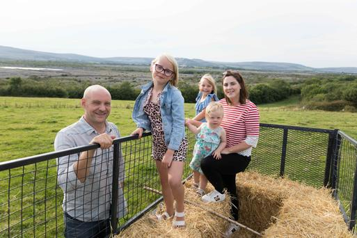 Cathal and Bronagh O'Rourke of Burren Farm Experience with their children Alice, Isla and Annabelle at home on the farm near Boston, Co Clare. Photograph by Eamon Ward