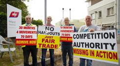 Frontline: Farmers protesting at the ABP plant, in Granagh, south Kilkenny last week (l-r): Michael Frisby, Moincoin, Kilkenny; Cllr Seanie Power, Waterford; Jim Cullinan, Kilbrien, Waterford and Kevin Barry, Cushinstown, Co Wexford. Photo: Mary Browne