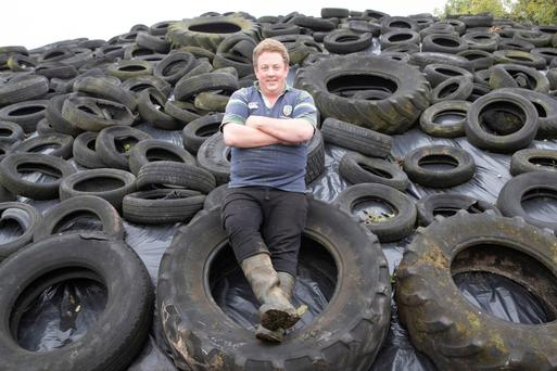 Tyre-ing work: Bill Gleeson on his farm in Tipperary; inset: on his tractor. Photo: Liam Burke/Press 22