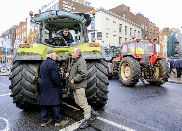 Blockade: Farmers Eamonn Cotterell, Michael Mc Donal and Derek Forde at the protest at St Stephen's Green. Photo by Gerry Mooney