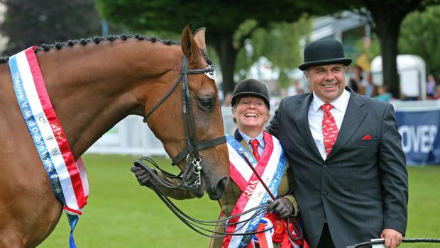 Shirley and Adrian Hurst celebrating after Tattygare Good To Go won the youngstock championship at the Dublin Horse Show in 2013 (Photo: E.S. Photography)