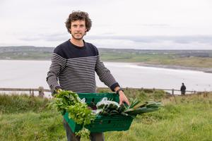 New approach: Fergal Smith of Moy Hill Community Farm with some fresh produce at the Reko Ring Group in Lahinch Co Clare. Photo: Natasha Barton