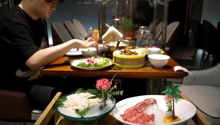 Different tastes: A dish with slices of raw beef imported from the US at the Jingli hotpot restaurant, in Beijing. Photo: Reuters