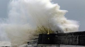Giant waves break over the South pier in Arklow, Co Wicklow during storms last week. Photo: Garry O'Neill