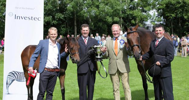 Maurice and Patrick Wafer receiving their prize for Parkmore Evita and her filly foal by Robin De La Maison, winners of the Investec Wealth & Investment All-Ireland Broodmare & Foal Team Championship at Iverk Show in 2015. Also pictured is Aengus Wilson of Investec and show chairman Robert Dowley