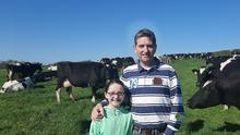 Out in front: Michael Marnane and his daughter Avril (8) with some of the herd on the farm at Kilfeacle.