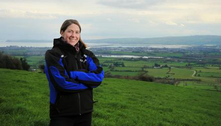 "Gillian O'Sullivan pictured on the family farm in Dungravan, Co Waterford. She says Glanbia's plan to introduce restrictions on peak milk supplies in 2022 ""shows little respect for the farmers the company is built on."""