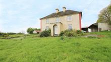 There is a substantial farmyard and 50ac of grazing ground.