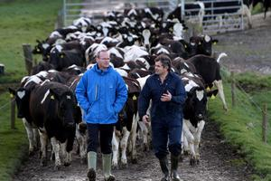 Minister Coveney pictured with Laois dairy farmer Bobby Hovenden last year in the run-up to the abolition of EU milk quotas