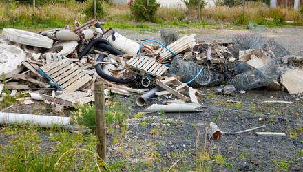 A reader is worried that the value of land he intends selling could be affected by his neighbour's growing pile of rubbish