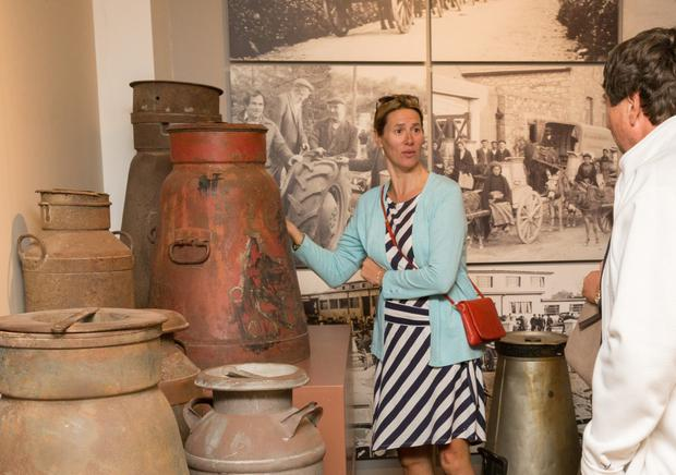Anna Hosford viewing the display of milk churns at the Butter Museum. Ms Hosford is a grandaughter of Con Murphy of C. Murphy and Son Ltd, the Cork butter blenders.
