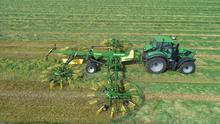 Lifting 30-foot swaths of grass and tackling 200 acres a day has led to rising harvester horsepower.