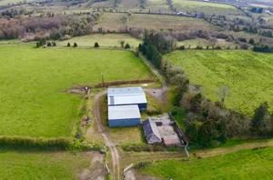The modernised farmyard that includes a double A-roofed slatted shed and cattle handling facilities.
