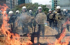 Farmers showered police with straw and set bales alight during their protest in Brussels. AFP/Getty Images.
