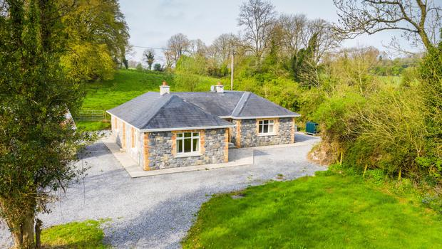 A renovated cottage on mature grounds at the centre on a 25ac holding 8km from Mullingar