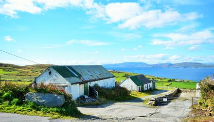 The farm buildings at Reagh, Kilcrohane are on a lovely site but acquisition of residential planning could be challenging.