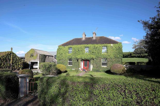 The two-storey farmhouse with the farm in Ballyroan needs refurbishment but has lots of character
