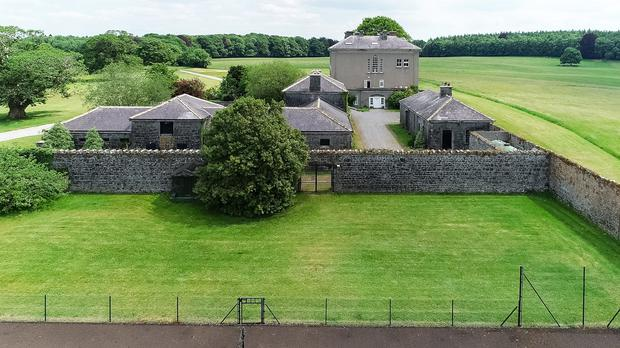 The enclosed courtyard is comprised of an impressive range of stone outbuildings