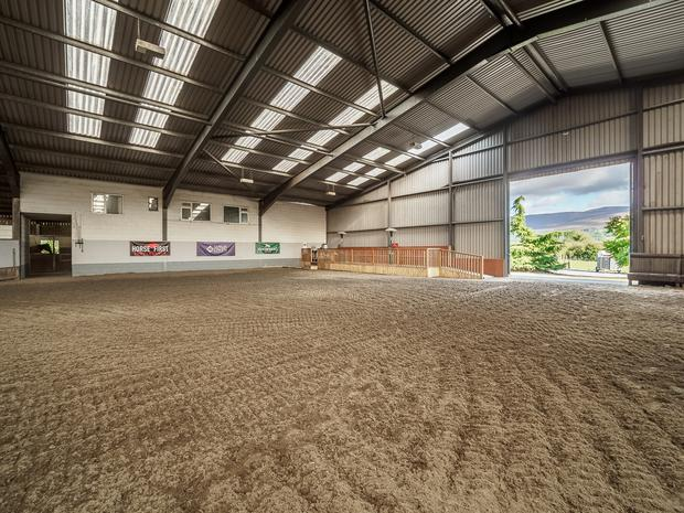 The equestrian facilities include a 200' x 115' indoor arena