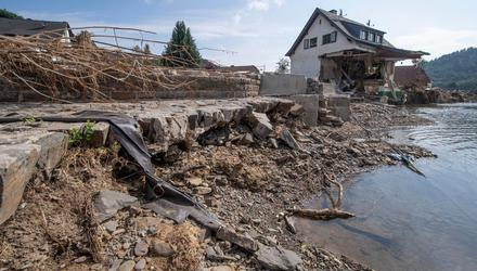 Damage: Extreme weather events such as the flooding that destroyed this house on the banks of the river Ahr in Insul, Germany, are predicted to become more common because of climate change. Photo: AP