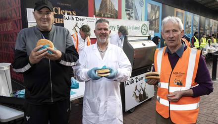 From left to right, Alan Finn of Lámh Fáilte Helping the Homeless; Paul Fletcher of Premier Game Ltd, Tipperary; and Ger O'Brien, Chairman, Wild Deer Association of Ireland (WDAI), enjoying some venison burgers on North Earl Street, Dublin. Photo: Damien Eagers