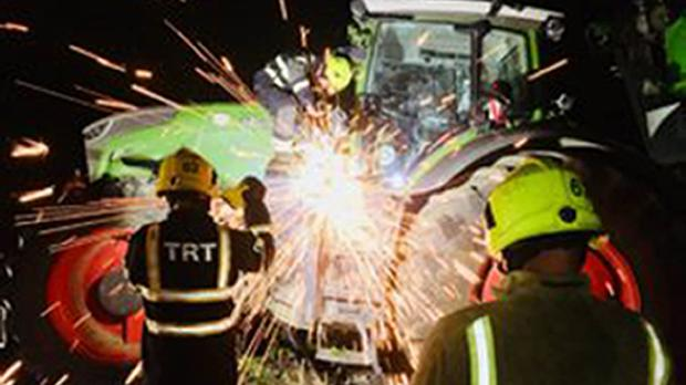 Firefighters tackle the tractor (West Yorkshire Fire and Rescue Service/PA)