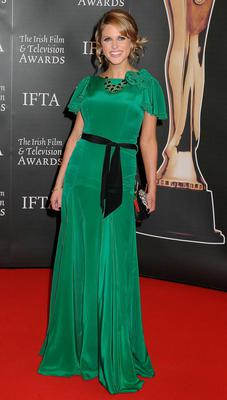 Emerald green is not always the easiest colour to wear but the actress looks stunning in this floor length dress from London label Belle  Bunty.