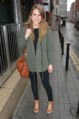 Huberman sports her essential green parka and a pair of her own shoe boots from Bourbon Footwear