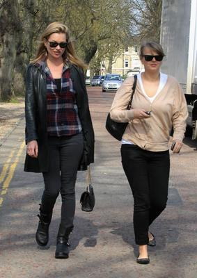 What to wear for an afternoon trip to your local boozer? If you're Kate, your skinnies, biker boots, a check shirt and a fitted leather coat.