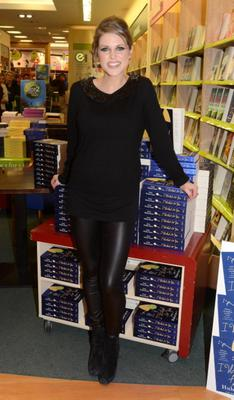 Pregnancy isn't going to stop this style star from experimenting. Amy relies on a pair of skintight leather trousers and black top with an embellished Peter Pan collar for a book signing at Easons, Dundrum.