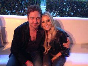 Claudine enjoys a night out with Robbie, who took the picture, and Scottish heartthrob Gerard Butler.