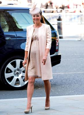 June 2013: She dresses her growing baby bump in a pink Jenny Packham dress, LK Bennett shoes and a Jane Taylor fascinator.