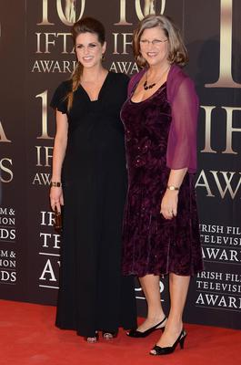 At this years IFTAs, a heavily pregnant Amy wore a classically elegant black gown (pictured with her mother Sandra)