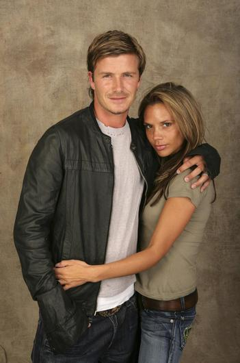David and Victoria Beckham pose for a studio portrait backstage at Live 8 London in Hyde Park on July 2, 2005 in London, England