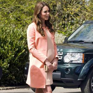 Kate looks positively peachy in this pastel combination.