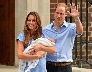 Prince William and Catherine, Duchess of Cambridge show their new-born baby boy to the world's media, standing on the steps outside the Lindo Wing of St Mary's Hospital in London on July 23, 2013