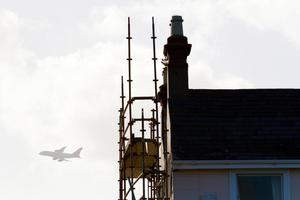 "No fee for repro â"" please credit Paul Sherwood  Flightfest â"" planes coming in over the Pigeon House power station, Ringsend, pictured from Sandymount Strand  British Airways Airbus A380 silhouetted over houses on Sandymount Strand"