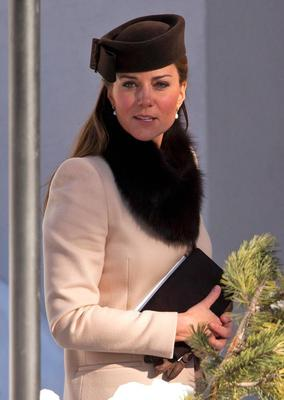 While attending a friend's wedding in Switzerland earlier this year, Kate accessorised to the max with a fur stole and complementary pillbox hat.