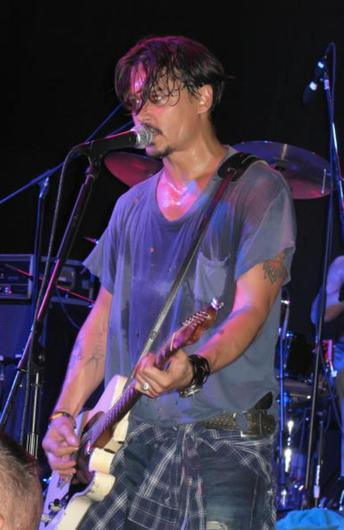 Johnny Depp performs with The Kids at Club Cinema on August 29, 2008