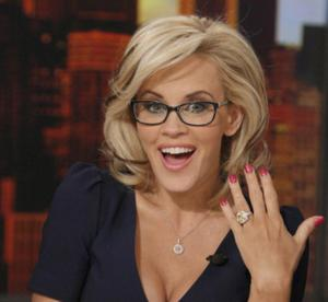 Comedienne Jenny McCarthy showed off her massive engagement ring to Donnie Wahlberg while co-hosting The View